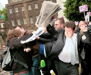 BNP leader Nick Griffin is pelted with eggs by anti-fascists